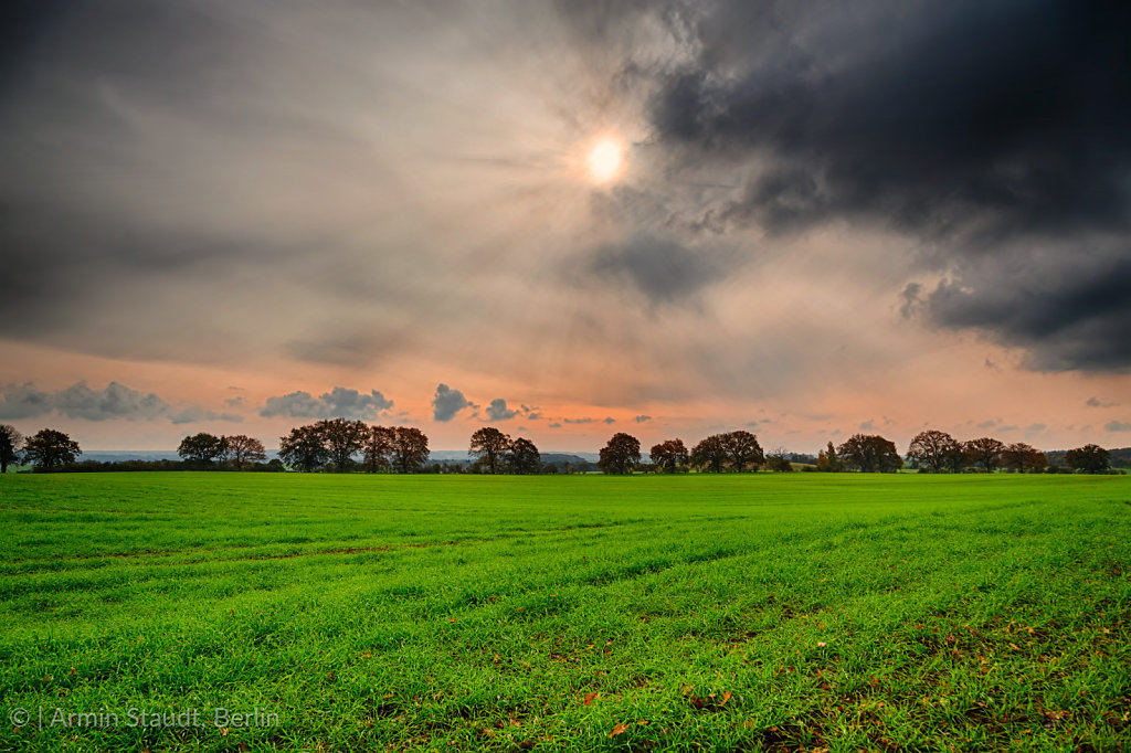 hdr shoot of a landscape with thunder clouds an the sun
