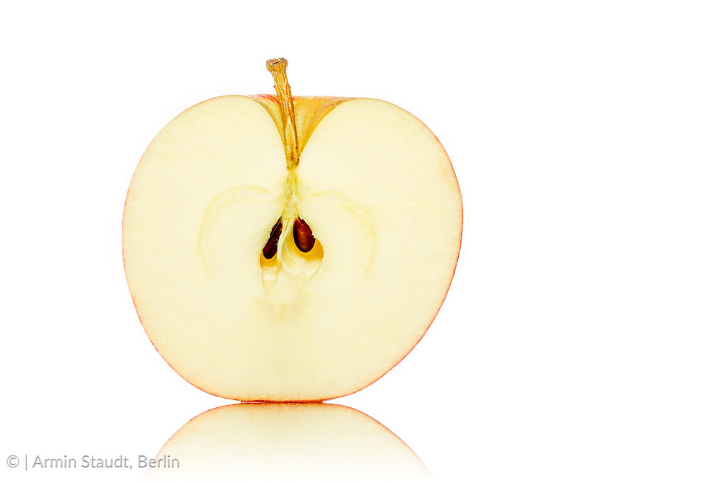 close up of a half of an apple, isolated on white