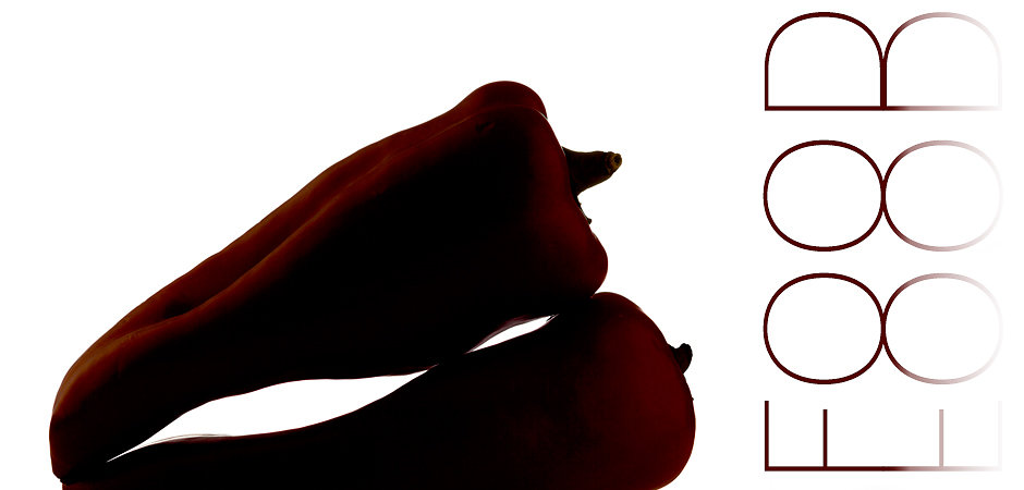 two red paprika in backlight, are laying on each other, isolated
