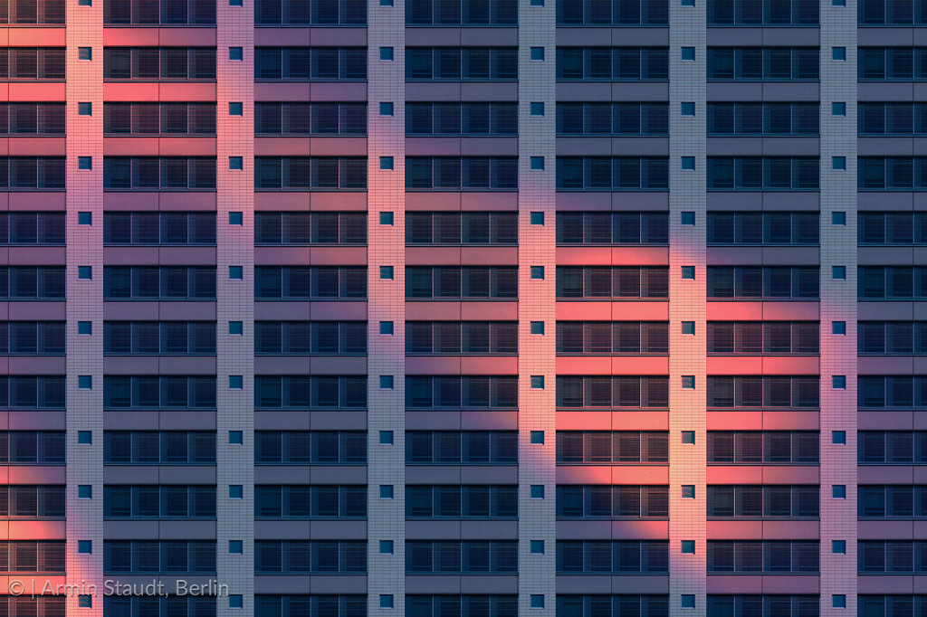 architectural pattern, reflected evening sun o a facade of a sparse house