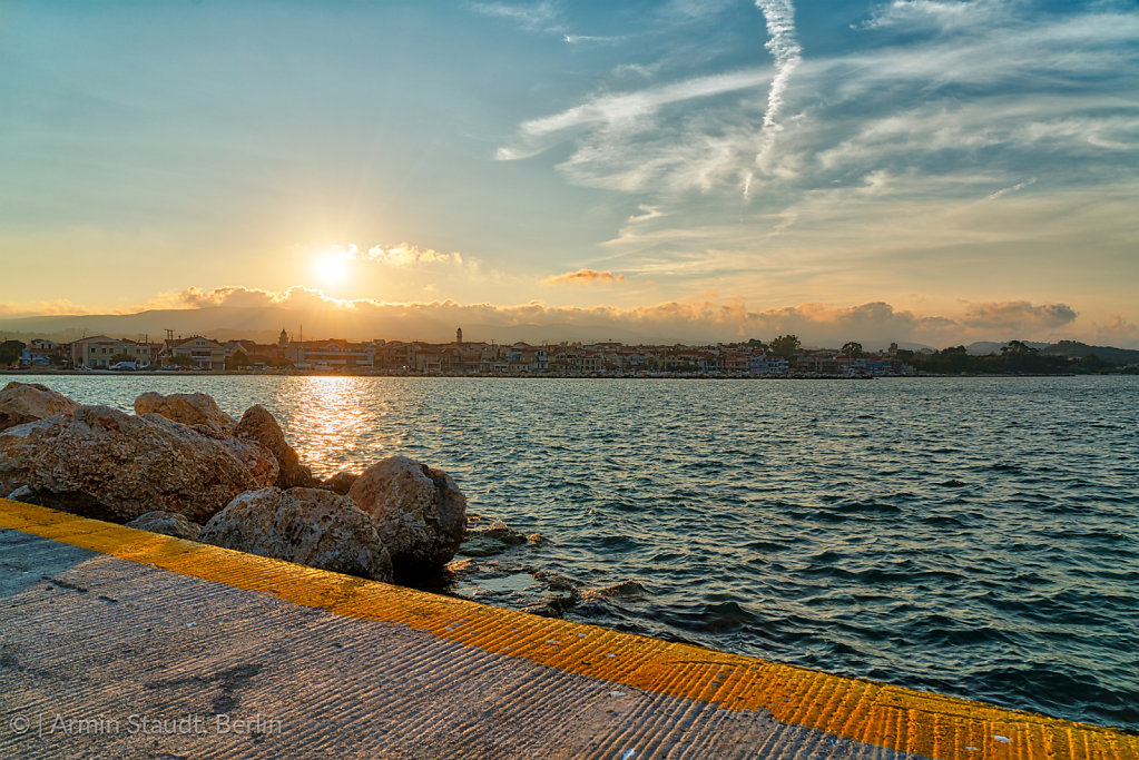 the harbor of Lixouri Kefalonia with ocean and sunset