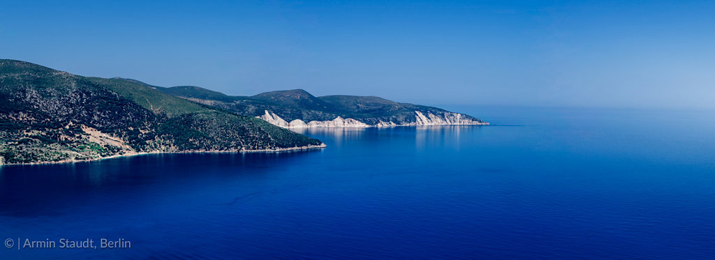 mediterranean panorama landscape, promontory in the deep blue sea