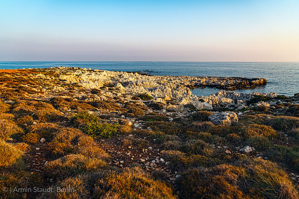 mediterranean landscape with rough rocks and ocean