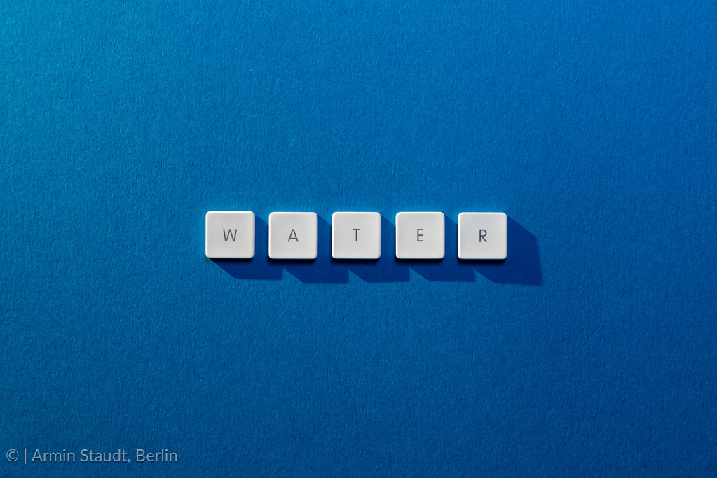 description of the word Water on a blue background