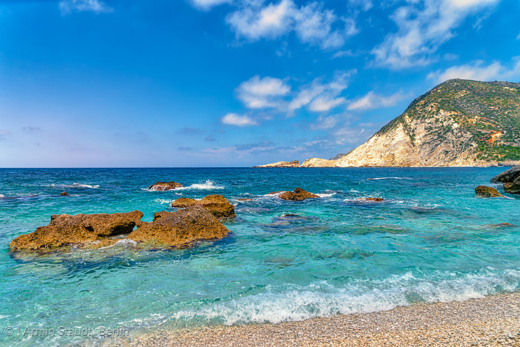 mediterranean landscape with stone beach in summer