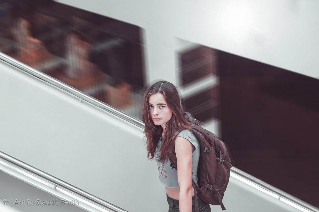 teen girl with backpack on a staircase