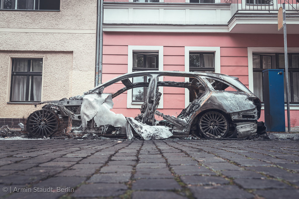 Burned out cars in the streets of Berlin