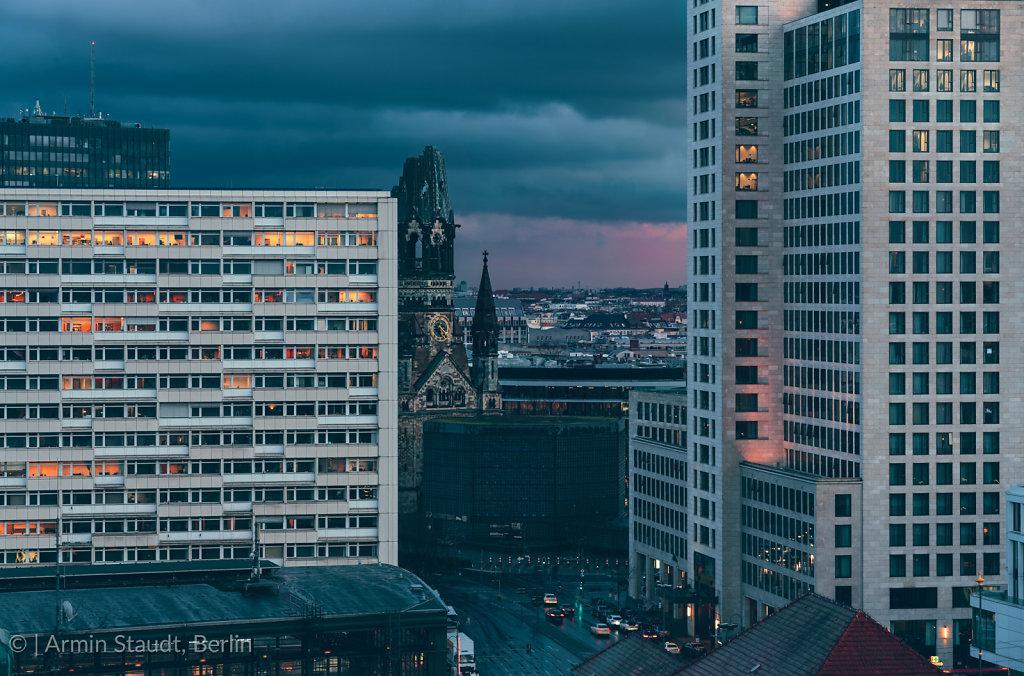 Gedächtniskirche Berlin in the evening, with dark clouds